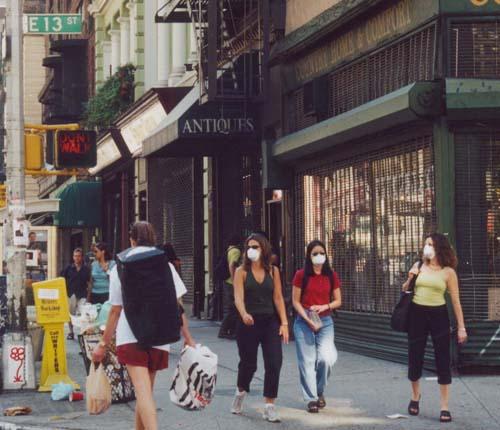 People walking around Washington Square and Broadway